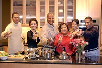 Extended Family Toasting Wine in Kitchen of In-law Suite