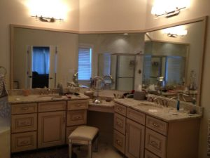 Master Bath with Him and Her Grey Vanities and Make-up Area