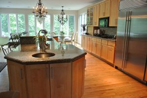 New Kitchen Design with Island Having Double Sink and Seating after remodeling